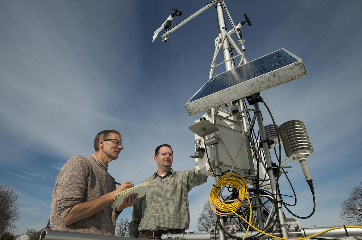 Photo of researchers at environmental monitoring station